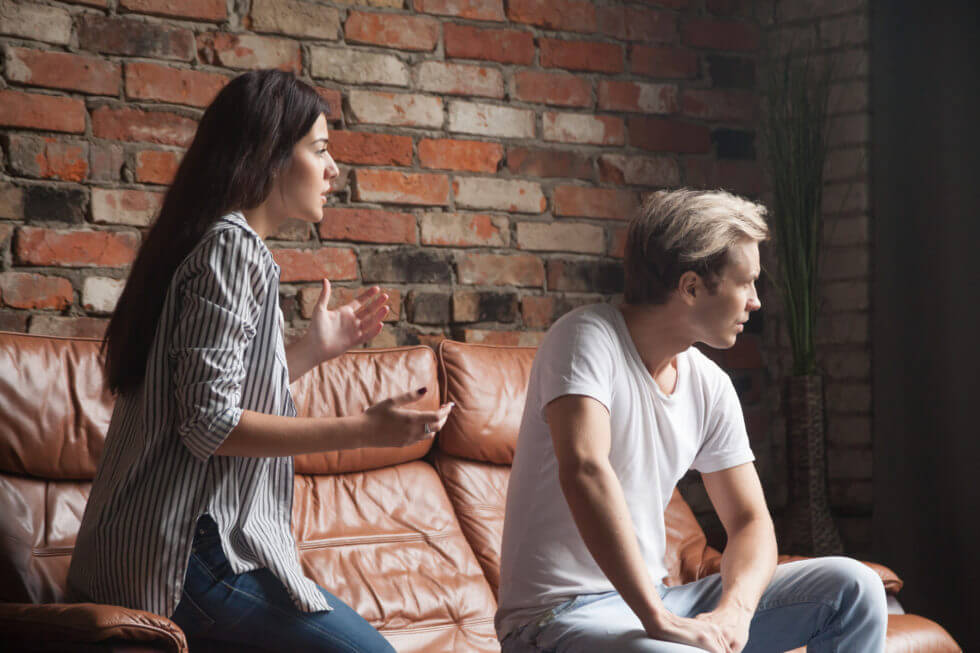 Young woman talking apologizing resentful man feels offended after conflict