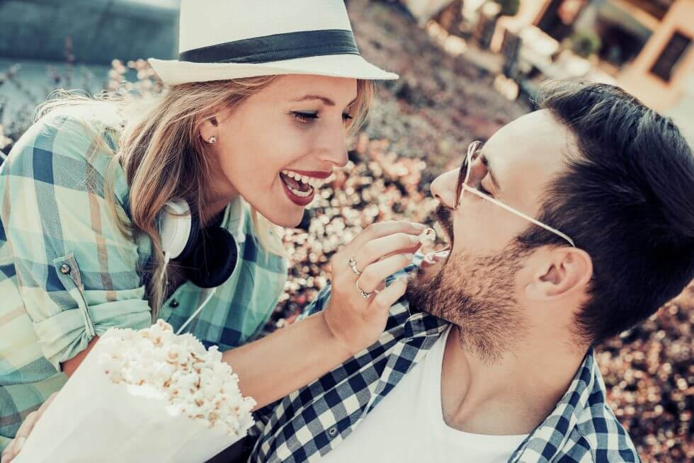 A couple eating popcorn