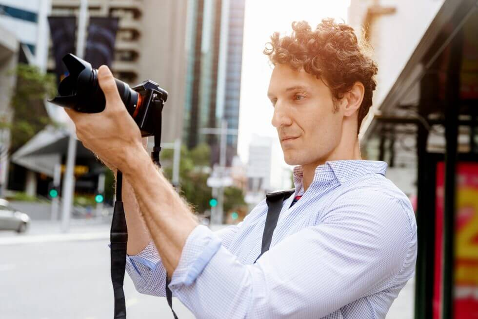 A man holding a camera